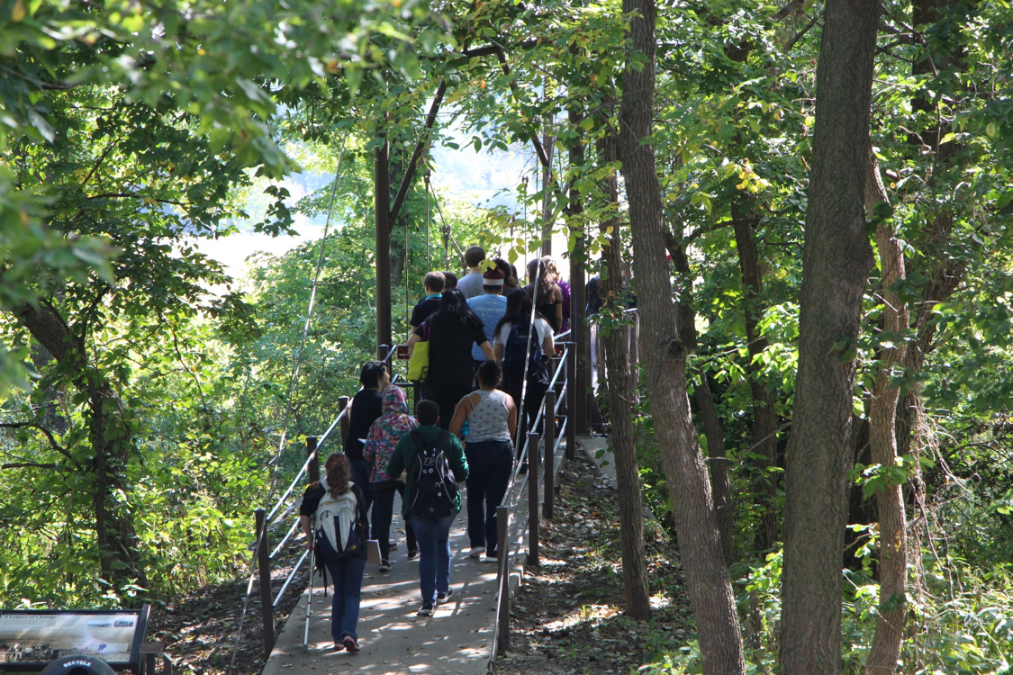 Students crossing a bridge at Homestead National Monument