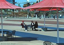People sitting at an outdoor table on Lewis and Clark Landing