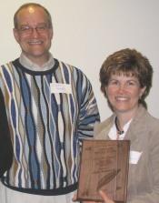 Robert Brooke and Linda Beckstead with her award