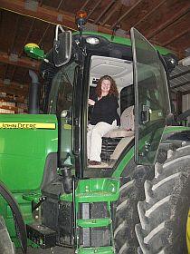 Susan in a BIG tractor
