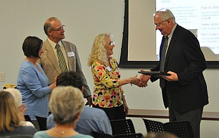 Robert Bussman accepts award from nominators and NeWP director