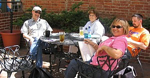 Group at an outdoor bistro table