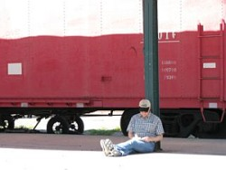 Robert in front of old train car