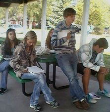Students writing outdoors awt Centennial Hall