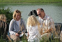 Writers sharing by the pond