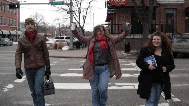 Teacher-writers cross a street during a winter writing marathon
