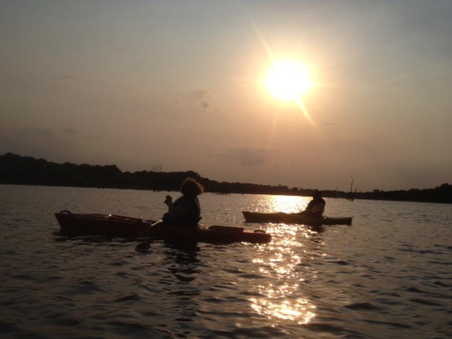 Omaha Writing Group members in kayaks at sunset