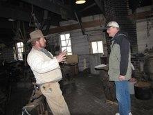 Robert Brooke with Stuhr Museum reenactor in cowboy hat