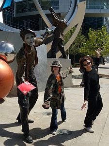Two participants posing with a mime outside the Qwest Center